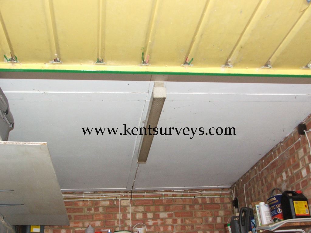 Asbestos boarding on ceiling of garage
